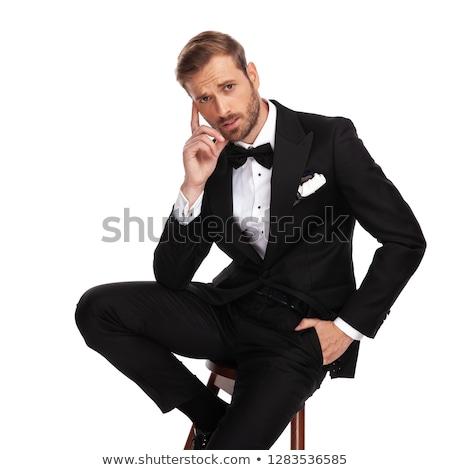 Jovem cavalheiro pensando sessão banquinho estúdio Foto stock © feedough