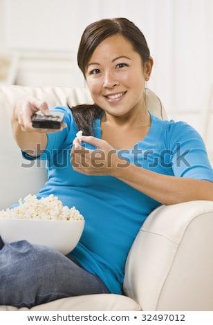Vertical image femme séance table popcorn Photo stock © deandrobot
