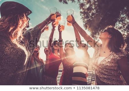 Model with orange cocktail Stock photo © bezikus