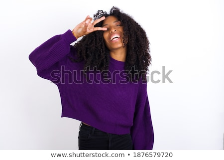 Young african hippie woman showing victory gesture Stock photo © RAStudio