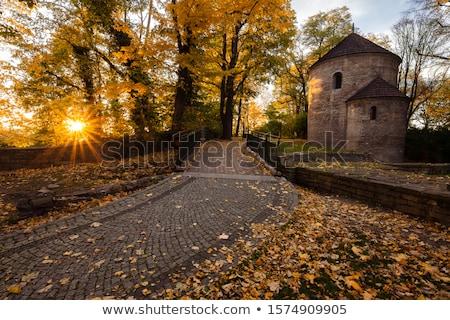 Küçük kilise Bina gün batımı kentsel kale ufuk çizgisi Stok fotoğraf © benkrut