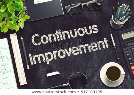 Stock photo: Continuous Improvement on Black Chalkboard. 3D Rendering.