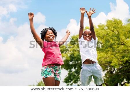 мальчика прыжки поднятыми руками вверх возбужденный Сток-фото © RAStudio