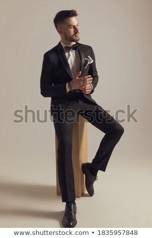 seated elegant man wearing rings is  dreaming away Stock photo © feedough