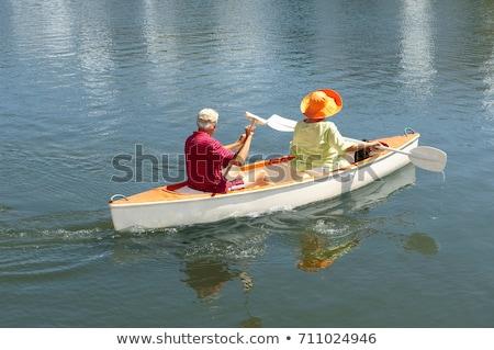 Ouder paar roeien kano meer liefde Stockfoto © IS2