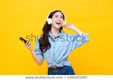 肖像 かなり アジア 少女 イヤホン 携帯電話 ストックフォト © deandrobot