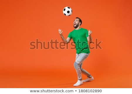 Full length portrait of an excited cheerful man celebrating stock photo © deandrobot