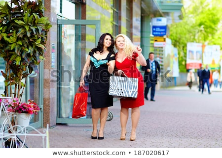Happy overweight woman in fashionable clothes Stock photo © Traimak