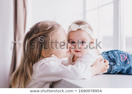 happy little girls or sisters hugging at home Stock photo © dolgachov
