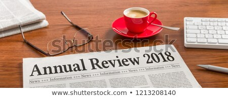 a newspaper on a wooden desk   annual review 2018 stock photo © zerbor
