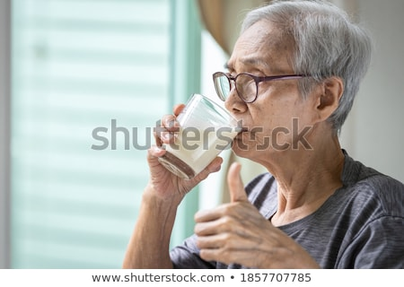 Maintaining the health of elderly woman in retirement concept Stock photo © boggy