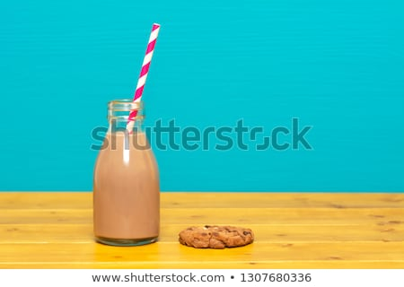 chocolate milkshake with straw in a bottle with a cookie stock photo © sarahdoow
