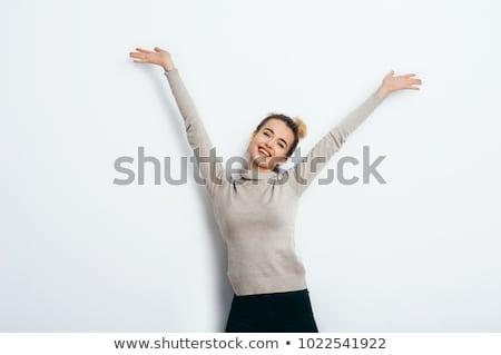 Hipster young girl over wall. Stock photo © artfotodima