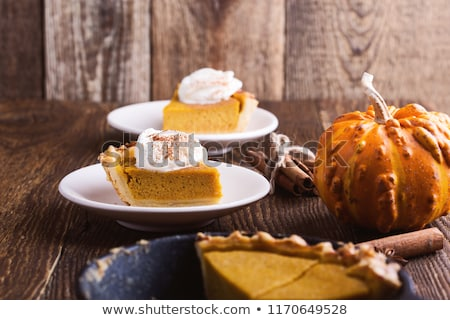 close up of pumpkins on wooden table stock photo © dolgachov