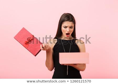 Zaklatott nő visel fekete ruha tart üres Stock fotó © deandrobot