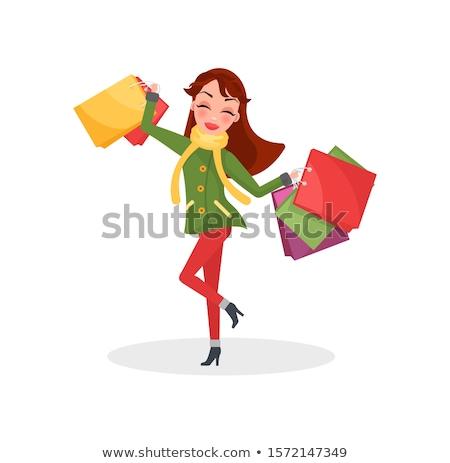 Uśmiechnięta kobieta ciepły płaszcz spodnie przedstawia prezenty Zdjęcia stock © robuart