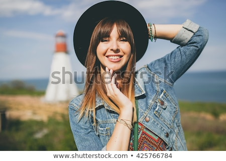 Portrait of a smiling young girl in denim jacket Stock photo © deandrobot