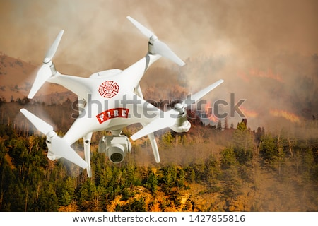 Aeronave isolado acima incêndio florestal fogo Foto stock © feverpitch