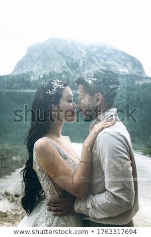 Verdubbelen bruiloft bruid bruidegom zoenen Stockfoto © robuart