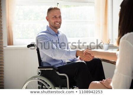Disabili imprenditore partner felice seduta Foto d'archivio © AndreyPopov