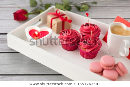 close up of cupcakes with heart cocktail sticks stock photo © dolgachov