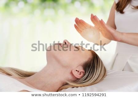 Mujer reiki curación tratamiento primer plano mano Foto stock © AndreyPopov