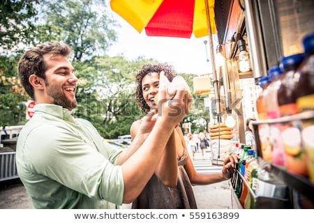 customers couple ordering hamburgers at food truck Stock photo © dolgachov