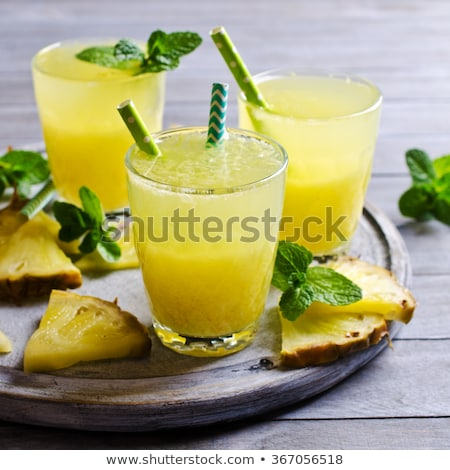 Stockfoto: Pineapple Cocktail With A Slice Of On Wooden Background And Inscription In Chalk Tropical Concept
