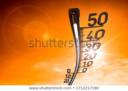 Global warming with hot sun shining the earth Stock photo © bluering