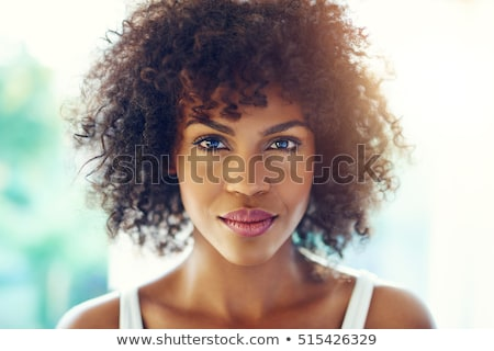 Pretty woman with a beautiful smile and curls of smooth hair holds an apple in her hand close-up Stock photo © ElenaBatkova