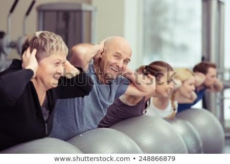 Group of seniors doing sport and gymnastics with balls Stock photo © Kzenon