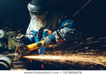 Metalworker working with angle grinder Stock photo © Kzenon