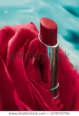 Red lipstick and rose flower on liquid background, waterproof gl Stock photo © Anneleven