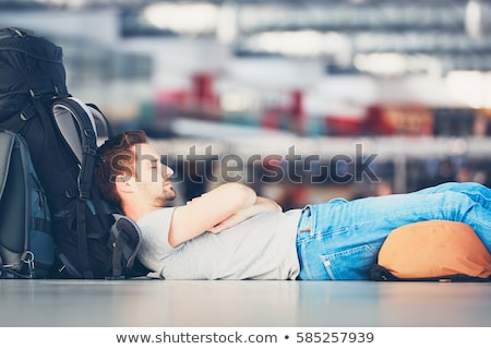 Man Sleeping In Airport Terminal Stock photo © AndreyPopov