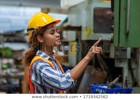 Young worker programming lathe machine in factory Stock photo © Kzenon