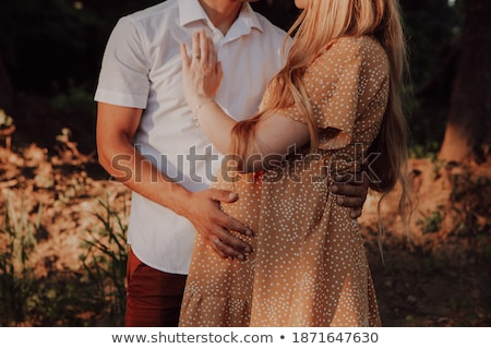 Caring husband hugs his pregnant wife. Couple awaiting baby Stock photo © ruslanshramko
