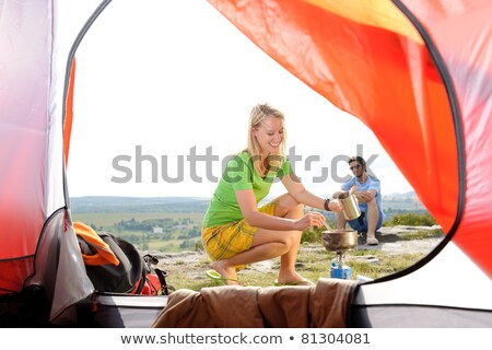 young camping couple cooking meal outside tent stock photo © candyboxphoto