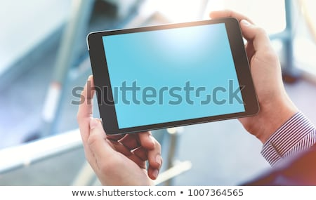 businessman holding tablet pc stock photo © bloomua
