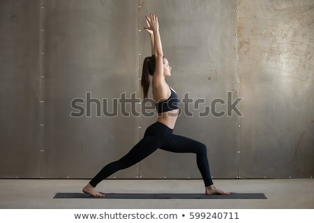 Yoga Warrior One pose Virabhadrasana by fit woman Stock photo © darrinhenry