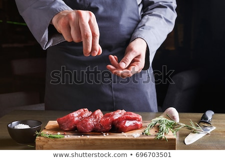 Pieces of meat with seasonings on a board Stock photo © romvo