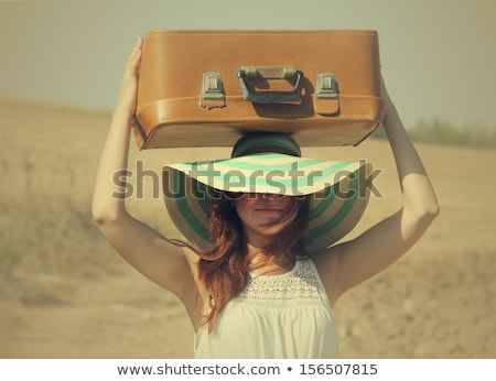 Portrait of the lovely woman with suitcase Stock photo © dashapetrenko