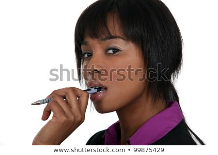 A pensive woman chewing on her pen Stock photo © photography33