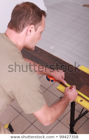 Man marking off laminate flooring with pencil Stock photo © photography33