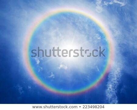 Halo em torno de sol céu círculos azul Foto stock © pzaxe