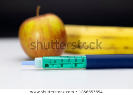 Doctor injecting hormone drugs into an apple Stock photo © photography33