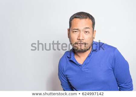 Handsome Man with Roguish Grin stock photo © lisafx