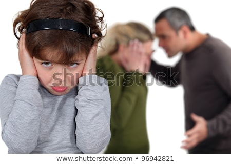 Stock photo: Little Girl Blocking Out Her Parents Argument