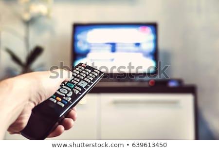 Homem televisão remoto tecnologia monitor tempo Foto stock © photography33