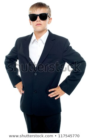 Confident little master wearing suit and shades stock photo © stockyimages