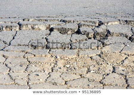 damaged cracked asphalt pattern texture stock photo © tarczas